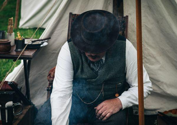 man in old tent