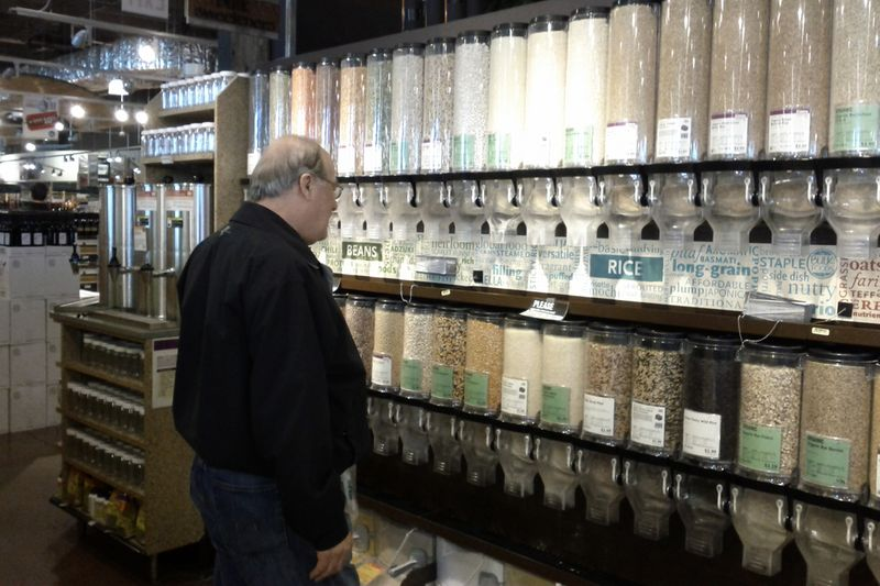 Man looking at bulk foods